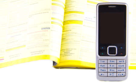 Cell phone with phone book on the background  photo