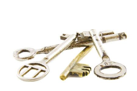 Pile of old keys isolated over white Stock Photo - 6069190