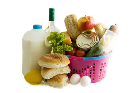 Basket filled with groceries isolated over white