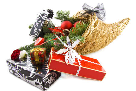 Luxury cornucopia filled with decorative presents isolated over white