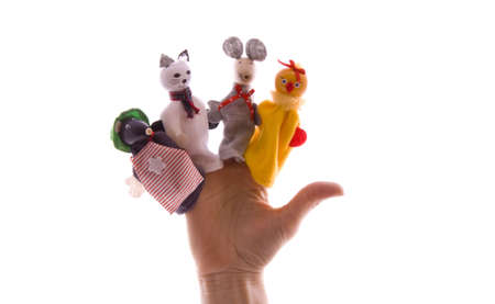 Hand with finger puppets isolated over white photo