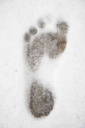 Footprint in the snow at the sauna Stock Photo