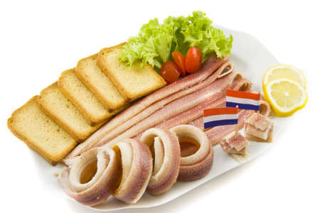 paling: Paling on a plate with flags toast tomato salad and lemon