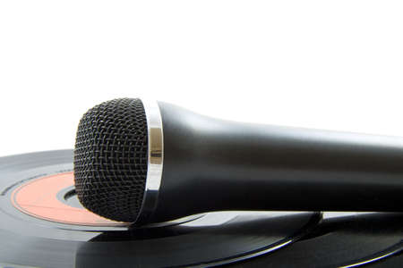 tracks live: Microphone laying on vinyl records isolated over white