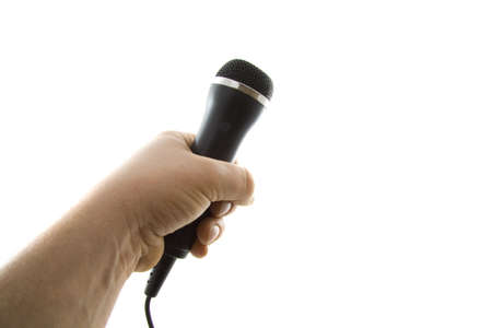 narrate: Hand holding a microphone isolated over white