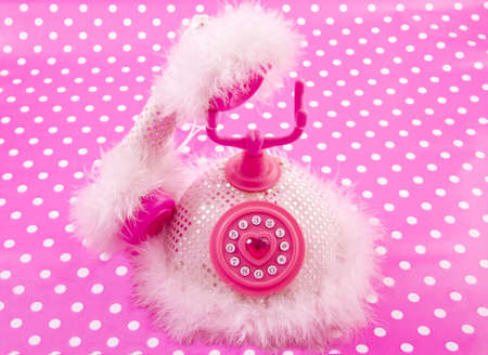 speckles: Pink princess phone on a pink white speckles background Stock Photo