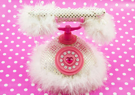 Pink princess telephone on a spotted pink background photo