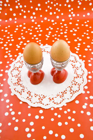 Two eggs in eggcups on a speckles background Stock Photo - 6496100