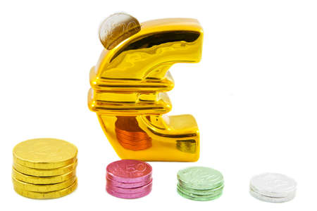 euromoney: Big golden euro symbol with colored coins in front isolated over white Stock Photo
