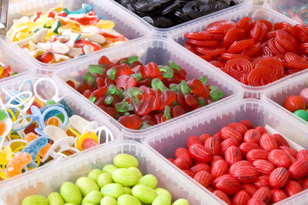 childhood obesity: Lots of boxes filled with different kind of candy Stock Photo