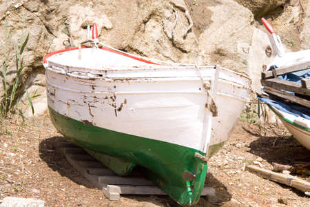 Fishing boat on the beach in traditional colors photo
