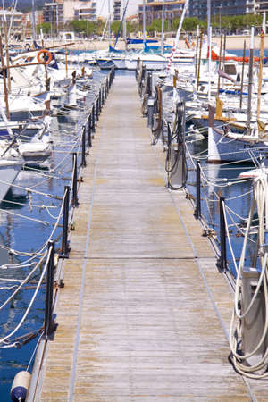 Lots of boats in a harbor with beach on the background Stock Photo - 7163840
