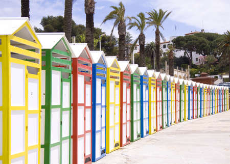 Dressing rooms in different color near a beach in spain photo