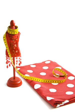 A tailor's dummy with measuring tape on a spotted red cloth Stock Photo - 7646800