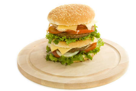 Big tasty hamburger on wooden plate Stock Photo - 7646793