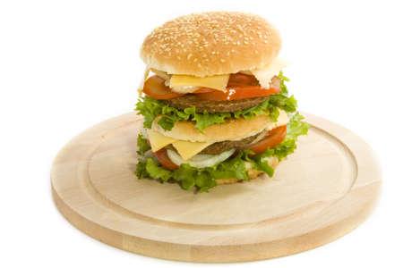 Big tasty hamburger on wooden plate Stock Photo - 7646793