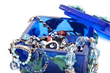 Blue jewel box with jewels isolated over white photo