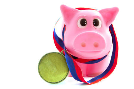 Pink pig with medal isolated over white photo