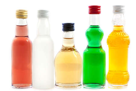 r fine: Bottles with liquor in different colors isolated over white Stock Photo