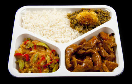 indonesian food: Special plate with indonesian food isolated over black