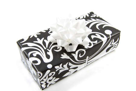luxery: Black silver present with knot isolated over white