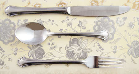Cutlery on a table in vintage style photo