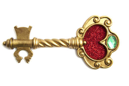 golden key: Golden fantasy key with red glitter heart isolated over white
