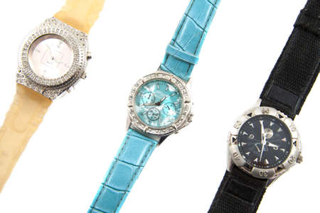 Three luxery watches isolated on a white background