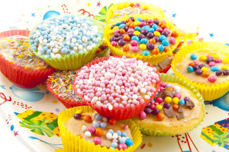 Decorated cup cakes on a pile ready to treat Stock Photo - 8432095