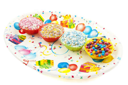 Four sweet cup  cakes on a decorated plate isolated over white Stock Photo - 8431957