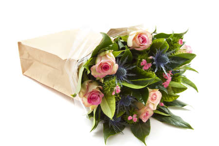 Bouquet with different kind of flowers in a paper bag isolated over white Stock Photo - 8432020