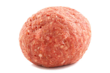Big raw meatball isolated on a white background photo