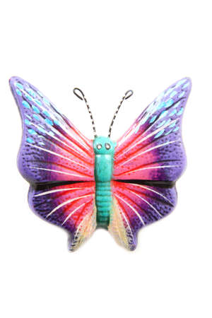Colorful fake butterfly isolated on a white background photo