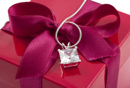 Gift box close up with diamond on necklace Stock Photo - 8506703