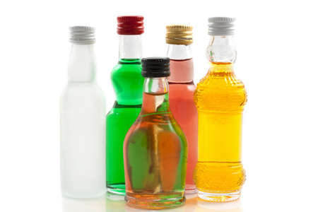 liqueur bottle: Colorful selection of bottles isolated over white