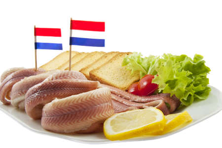 Fish with toast salat and lemon on a plate Stock Photo - 8508655