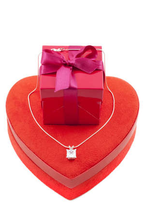 Red gift box in the shape of a heart  with luxury necklace Stock Photo - 8554202