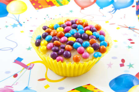 felicitation: Sweet colorful cup cake on a decorated background Stock Photo