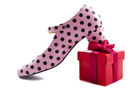 stilletto: Speckles shoe on red gift isolated over white