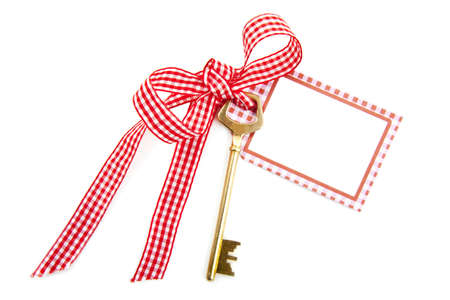 Key on ribbon with blank card isolated over white Stock Photo - 8574561