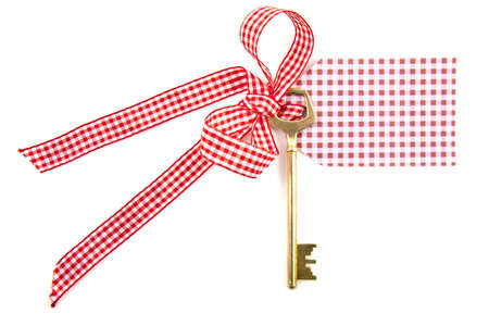 Key on ribbon with card isolated over white Stock Photo - 8574565
