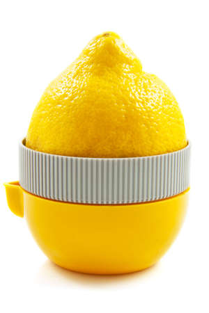 winepress: Lemon on juice press isolated over white Stock Photo