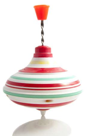 perinola: Vintage spinner en movimiento aislado en blanco