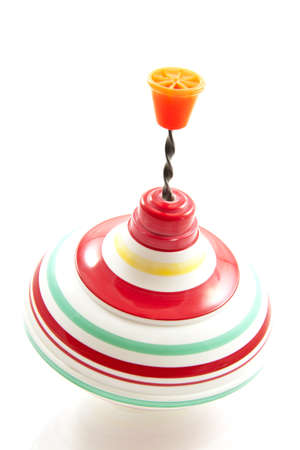 Spinning colorful old toy isolated over white Stock Photo - 8639677