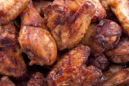 bbq background: Legs and wings marinated for background use