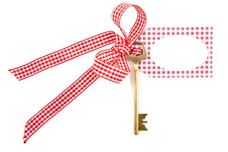 Key on ribbon with card isolated over white Stock Photo - 8808500