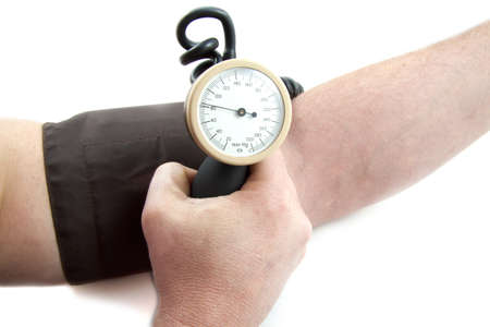 physical pressure: Arm with blood pressure equipment isolated over white