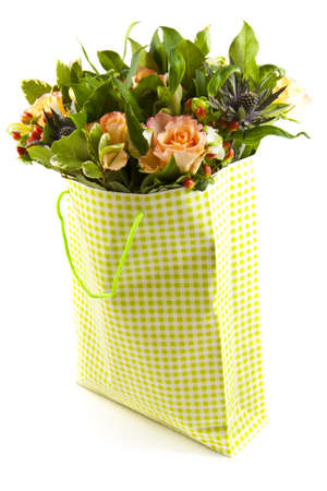 Bouquet with different kind of flowers in a bag isolated over white Stock Photo - 8808491