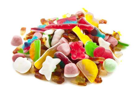 obesidad infantil: Lotes de dulces coloridos aislado en blanco Foto de archivo