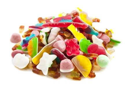 childhood obesity: Lots of colorful candy isolated over white Stock Photo